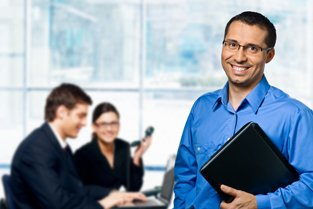 Man smiling at a business meeting in a modern office