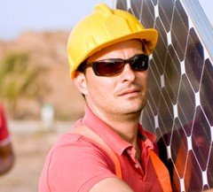 Men working with solar panels