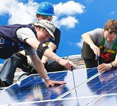 Solar Power Technician installing solar panels
